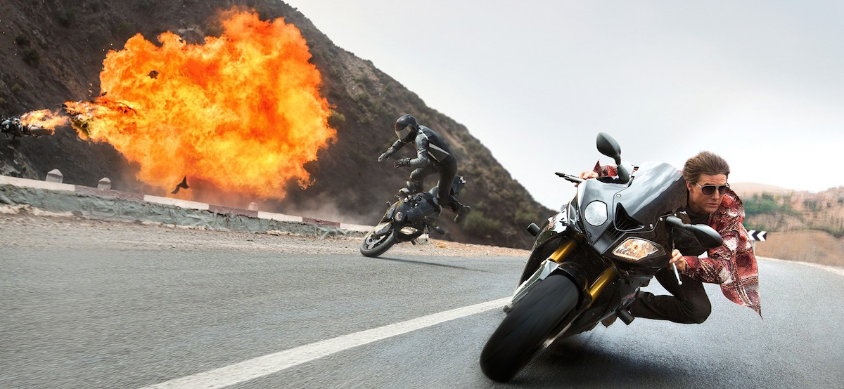 Tom Cruise doing something in Mission Impossible.